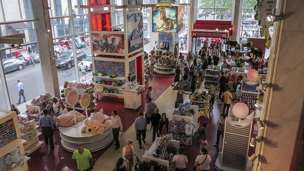 NEW YORK, NY - JULY 15: People walk inside the iconic toy store FAO Schwarz in New York during its last day in business on July 15, 2015, in New York City . The 153-year-old store, founded by German immigrant Frederick August Otto Schwarz, has become embedded in popular culture. Owner Toys R Us announced the decision in May, citing the high and rising costs of running the 45,000-square-foot retail space on pricey Fifth Avenue. (Photo by Bilgin S. Sasmaz/Anadolu Agency/Getty Images)