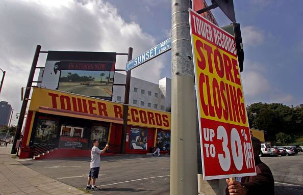 Lindsey Ikuta (cq) of Gardena snaps a photo with his camera phone at the Tower Records store on Sunset Blvd. Monday in West Hollywood October 09, 2006. Tower Records was sold last week to a liquidator. (Photo by Richard Hartog/Los Angeles Times via Getty Images)
